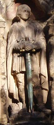 The statue of St Wystan above the church porch.  His sword was donated by Pamela Carr in 2003 in memory of her husband, Douglas, who died in 1991. Douglas was a major in The Royal Berkshire Regiment and saw active service in Malaya. When he left the army he became Secretary of Derbyshire County Cricket Club. He was much involved in the life of the village and served on the Church Council.